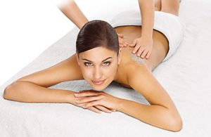 woman receiving steam and exfoliation treatment