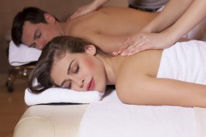 Couple relaxing in spa getting massage